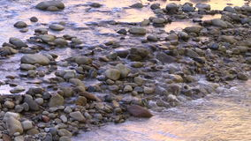 Tranquil Stream Flowing Over Rocks stock footage
