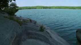 Tranquil summer reservoir (1 of 5). A view or scene on a body of water stock footage