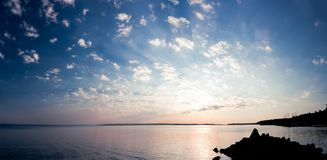 Tranquil sunrise panorama of lake and clouds Royalty Free Stock Photo