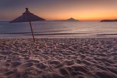Tranquil sunset scene with lone sun umbrella Royalty Free Stock Photos