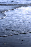 Tranquil tide. Lapping blue sea - shallow depth of field Royalty Free Stock Photos
