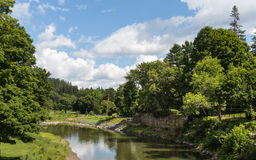 Tranquil Vermont. This image was taken from the Woodstock Middle Bridge showing a tranquil river wandering through the Vermont greenery stock photos