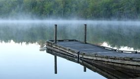Tranquil video of small wharf with morning mist stock video