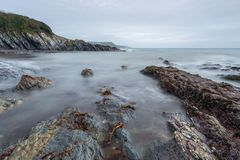 Tranquil View over Rocks, Polridmouth Cove, Gribbin Head, Cornw stock photos