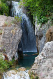 Tranquil Water Falls with Big Rocks on Side Royalty Free Stock Photos