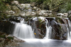 Tranquil waterfall scene. A tranquil scene of a flowing river cascading over rocks Stock Photo