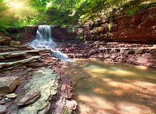 Tranquil waterfall scenery Royalty Free Stock Images