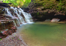 Tranquil waterfall scenery Royalty Free Stock Photos