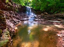 Tranquil waterfall scenery in the forest Royalty Free Stock Images