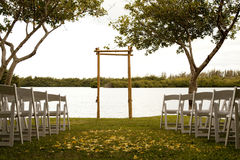 Tranquil wedding setting. With trellis, water and trees Stock Image
