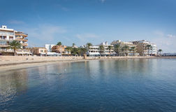 Tranquil winter bay and hotels. CAN PASTILLA, MALLORCA, BALEARIC ISLANDS, SPAIN - DECEMBER 13, 2015: Tranquil winter bay, hotels and seagulls feeding in water on Stock Images