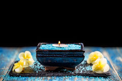 Tranquile scene. Aromatic sea salt and aroma candle, tranquile scene Royalty Free Stock Photo