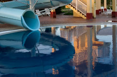 Tranquility. Pool reflection of a waterless waterslide Royalty Free Stock Images