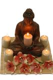 Tranquility. A tranquil scene; Buddha, candles and orchid Royalty Free Stock Image