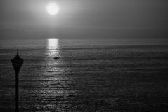 Tranquility. A boat crossing sea during a sunset in Acapulco Stock Photos