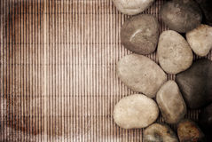 Tranquility Concept Grunge Background. With Bamboo And Stones Stock Images