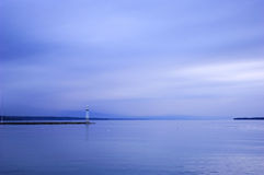Tranquility lough. With a pharos in the morning, geneva lake, switzerland Stock Images