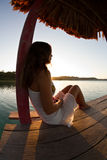 Tranquility over Guatemala. A young Woman enjoys dawn on lago Peten Stock Images