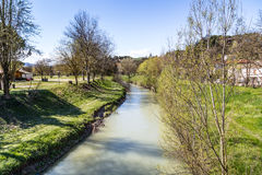 The tranquility of a quiet river in the countryside of the hills Royalty Free Stock Image
