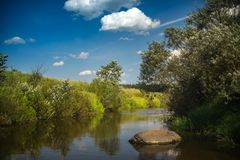 Tranquility sunny landscape near small river stock photos