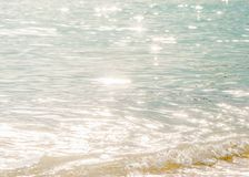Tranquility time, beautiful surface of seawater in the morning, bright glittering star bokeh, soft waves and bubble. Tropical sea. In summer stock photography