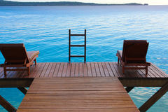 Tranquility, vanuatu. Deck chair overlooking the bay in vanuatu Stock Photography