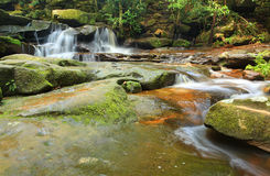 Tranquility waterfalls and moss covered rocks Stock Photo
