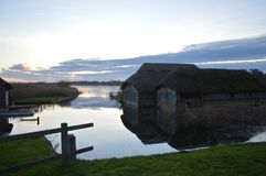 Tranquillity at the Hickling Broad Norfolk Thatched Boathouses Royalty Free Stock Photos