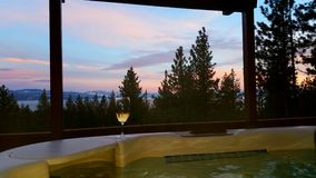 Tranquillity. Hot tub and wine with a view royalty free stock image