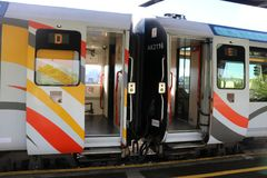 Trans Alpine Express train open carriage doors. Open doors on cars D and E await passengers for the Trans Alpine Express train at Christchurch railway station on Stock Image