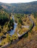 The TRANS-Siberian railway at the river Olkha in the Baikal region. The TRANS-Siberian railway to the Baikal pass station Irkutsk-Slyudyanka between the stopping Royalty Free Stock Photography