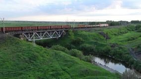 Trans-Siberian Railway Train Passing Over Bridge. Freight Train Passing Over The Railway Bridge In Countryside, Trans-Siberian Railway stock video