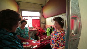 TRANS-SIBERIAN TRAIN, MONGOLIA/RUSSIA : Women playing card stock video