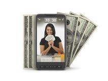 Transacciones del dinero por el teléfono celular fotos de archivo libres de regalías