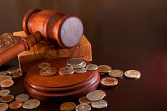 The transaction is completed. Coins from different countries and gavel Stock Photo