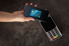Transaction completed with mobile credit card. Transaction completed on terminal with mobile credit card stock photography