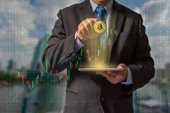 Transactions on the Internet by trading through bitcoin currency blockchain technology through financial data through secure stock image