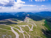 Transalpina road and Ranca town in Romania. Aerial view royalty free stock photo