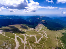 Transalpina road and Ranca town in Romania. Aerial view royalty free stock photos