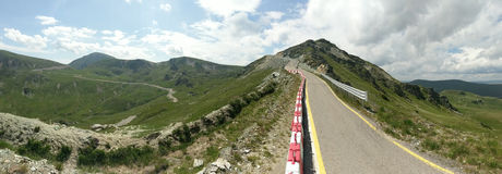Transalpina road in Romania. Transalpina road, a narrow twisting scenic route through the mountains of Romania here with with steep drops to moorland on the left royalty free stock image