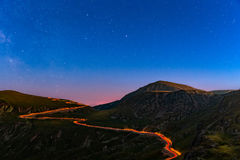 Transalpina road under a starry night Stock Images