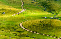 Transalpina road and Urdele peak. Mountain Valley Highlands Stock Photos