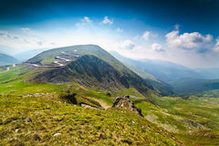 Transalpina road and Urdele peak in Romania. Landscape with Transalpina road and Urdele peak of Parang mountains in Romania royalty free stock images