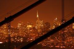 Transamerica Building. San Francisco in the night with the Transamerica Building seen through the cables of the Golden Gate bridge Stock Photos