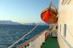 Transatlantic deck lifeboat mountains morning Royalty Free Stock Photos