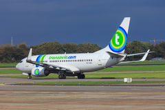 Transavia jet taxiing out. A Transavia Boeing 737-700 taxiing for takeoff at Rotterdam airport royalty free stock images