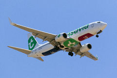 Transavia 737 with underside beach and skiing logos Royalty Free Stock Photos