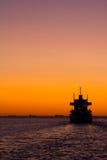 Transbordador en la puesta del sol Fotos de archivo