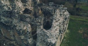 Aerial shot: Ruins of the ancient castle of the Knights Templar. Transcarpathia ruins XIII century According to one version castle erected representatives of the stock video