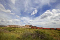Transcontinental train in the USA. Train traveling from coast to coast with cargo through the desert Stock Images